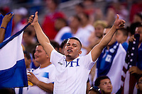 A Honduran fan cheers during the quarterfinals of the CONCACAF Gold Cup at M&T Bank Stadium in Baltimore, MD.  Honduras defeated Costa Rica, 1-0.