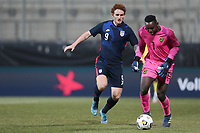WIENER NEUSTADT, AUSTRIA - MARCH 25: Josh Sargent #9 of the United States and Jeadine White #1 of Jamaica during a game between Jamaica and USMNT at Stadion Wiener Neustadt on March 25, 2021 in Wiener Neustadt, Austria.