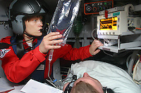 Doctor tends to patient in flight during a mission. Pictures of Norwegian Air Ambulance at work, operating out of Trondheim. The helicopter crew consist of a pilot, a crew member/rescue professional, and a physician. Siv Moen