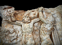 Close up of a Roman Sebasteion relief sculpture of Zeus and Prometheus, Aphrodisias Museum, Aphrodisias, Turkey.   Against a black background. <br /> <br /> Prometheus is screaming in pain. Zeus had given him a terrible punishment for giving fire to man: he was tied to the Caucasus mountains and had his liver picked out daily by an eagle. Herakles shot the eagle and is undoing the first manacle. He wears his trade mark lion-skin and thrown his club to one side. A small mountain nymph, holding a throwing stick appears amongst the rocks.