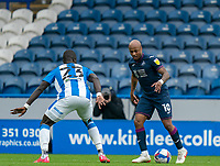 20th February 2021; The John Smiths Stadium, Huddersfield, Yorkshire, England; English Football League Championship Football, Huddersfield Town versus Swansea City; André Ayew of Swansea City on the ball as Mouhamadou-Naby Sarr of Huddersfield Town defends