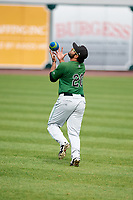 Clinton LumberKings pitcher Marvin Gorgas (20) chases a football before a game against the West Michigan Whitecaps on May 3, 2017 at Fifth Third Ballpark in Comstock Park, Michigan.  West Michigan defeated Clinton 3-2.  (Mike Janes/Four Seam Images)