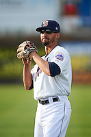 Binghamton Mets third baseman Derrik Gibson (15) warms up before a game against the Trenton Thunder on May 29, 2016 at NYSEG Stadium in Binghamton, New York.  Trenton defeated Binghamton 2-0.  (Mike Janes/Four Seam Images)