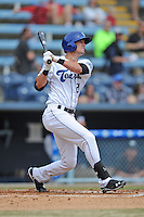 Asheville Tourists center fielder David Dahl #21 swings at a pitch during a game against the  Delmarva Shorebirds at McCormick Field on April 6, 2014 in Asheville, North Carolina. The Shorebirds defeated the Tourists 4-2. (Tony Farlow/Four Seam Images)