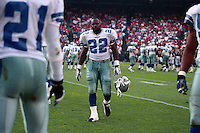 SAN FRANCISCO, CA - Running back Emmitt Smith of the Dallas Cowboys walks off the field during a game against the San Francisco 49ers at Candlestick Park in San Francisco, California in 1996. Photo by Brad Mangin