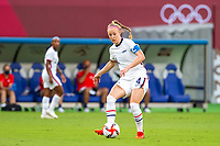 TOKYO, JAPAN - JULY 21: Becky Sauerbrunn #4 of the United States passes the ball during a game between Sweden and USWNT at Tokyo Stadium on July 21, 2021 in Tokyo, Japan.