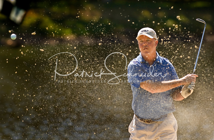 A golfer watches his shot from a bunker in Amelia Island, FL