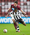 ST MIRREN'S NIGEL HASSELBAINK TRIES TO GET AWAY FROM HEARTS' RYAN MCGOWAN
