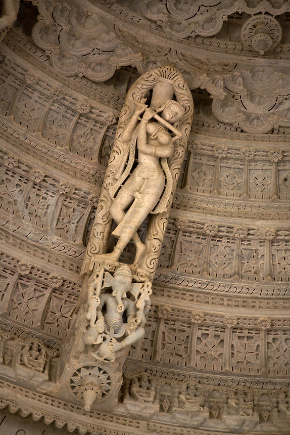 GANESH & CELESTIAL MUSICIAN inside a CUPOLA the CHAUMUKHA MANDIR TEMPLE at RANAKPUR in the Pali District of RAJASTHAN near Sadri - INDIA