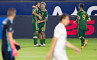 CARSON, CA - OCTOBER 07: Diego Valeri #8 and Pablo Bonilla #28 of the Portland Timbers celebrates a Timbers goal during a game between Portland Timbers and Los Angeles Galaxy at Dignity Heath Sports Park on October 07, 2020 in Carson, California.
