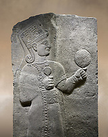 Photo of Hittite relief sculpted orthostat stone panel of Long Wall Basalt, Karkamıs, (Kargamıs), Carchemish (Karkemish), 900 - 700 B.C. Anatolian Civilizations Museum, Ankara, Turkey.<br /> <br /> Goddess Kubaba. Goddess is depicted from the profile. The part below the chest of the relief is broken. She holds a pomegranate in her hands on her chest. She carries a one-horned headdress on her head. Her braided hair hangs down to her shoulder. The text in the hieroglyphics is not understood. The lower part of the relief has been restored. <br /> <br /> On a brown art background.