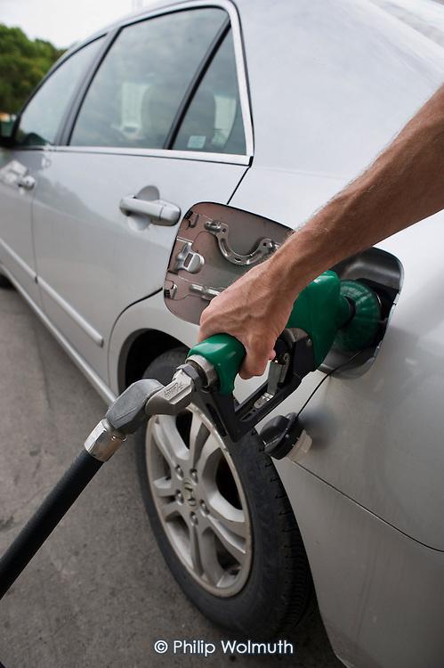 Fillin a car with petrol (gas), West Virginia, USA