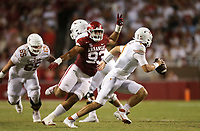 Arkansas defensive lineman Isaiah Nichols (93) rushes towards Texas quarterback Hudson Card (1), Saturday, September 11, 2021 during the third quarter of a football game at Reynolds Razorback Stadium in Fayetteville. Check out nwaonline.com/210912Daily/ for today's photo gallery. <br /> (NWA Democrat-Gazette/Charlie Kaijo)