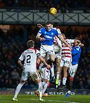 04.03.2020: Rangers v Hamilton: George Edmundson rises to win the ball