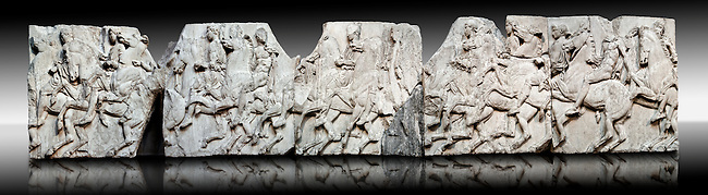 Marble Releif Sculptures from the frieze around the Parthenon Block XXXVII to XLI  100 to 114 . From the Parthenon of the Acropolis Athens. A British Museum Exhibit known as The Elgin Marbles