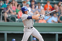 Infielder Jason Stolz (11) of the Asheville Tourists bats in a game against the Greenville Drive on Thursday, May 30, 2013, at Fluor Field at the West End in Greenville, South Carolina. Asheville won, 9-8. (Tom Priddy/Four Seam Images)