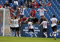 HOOVER, AL - DECEMBER 07, 2012:  Players of the University of Maryland celebrate with their fans after the first goal against Georgetown University during an NCAA 2012 Men's College Cup semi-final match, at Regents Park, in Hoover , AL, on Friday, December 07, 2012. The game ended in a 4-4 tie, after overtime Georgetown won on penalty kicks.