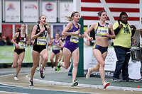 WINSTON-SALEM, NC - FEBRUARY 08: Sammy George #11 leads Savanah Carnahan #8 of Furman University and Hannah Steelman #9 of Wofford College through the turn in the Women's Camel City Elite 3000 Meters at JDL Fast Track on February 08, 2020 in Winston-Salem, North Carolina.