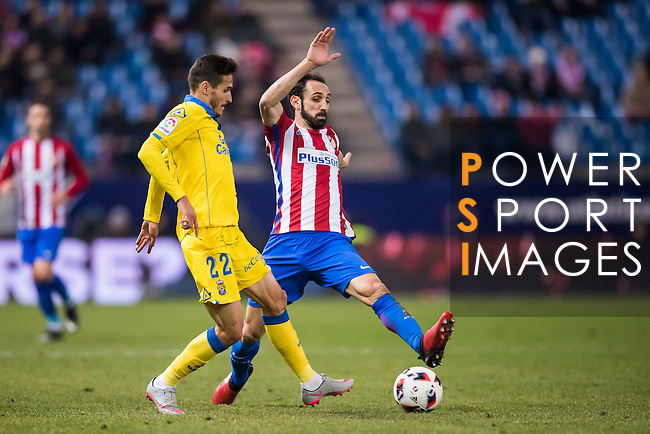 """Juan Francisco Torres Belen """"Juanfran"""" of Atletico de Madrid fights for the ball with Helder Lopes of UD Las Palmas during their Copa del Rey 2016-17 Round of 16 match between Atletico de Madrid and UD Las Palmas at the Vicente Calderón Stadium on 10 January 2017 in Madrid, Spain. Photo by Diego Gonzalez Souto / Power Sport Images"""