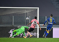 Calcio, Serie A: Juventus - Hellas Verona, Turin, Allianz Stadium, October 25, 2020.<br /> Hellas Verona's Andrea Favilli (r) scores in spite of Juventus' goalkeeper Woyciech Szczesny (l) and Danilo (c) during the Italian Serie A football match between Juventus and Hellas Verona at the Allianz stadium in Turin, October 25,,2020.<br /> UPDATE IMAGES PRESS/Isabella Bonotto