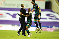 Steve Cooper Head Coach of Swansea City celebrates at full time with Andre Ayew and Rhian Brewster during the Sky Bet Championship match between Reading and Swansea City at the Madejski Stadium in Reading, England, UK. Wednesday 22 July 2020.