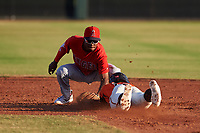AZL Angels Drevian Williams-Nelson (6) applies the tag to Edison Mora (18) on a stolen base attempt during a game against the AZL Giants Orange at Giants Baseball Complex on June 17, 2019 in Scottsdale, Arizona. AZL Giants Orange defeated AZL Angels 8-4. (Zachary Lucy/Four Seam Images)