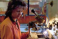- woman worker in the metal and mechanics industry TECAS in Edolo (Sondrio)....- operaia nell'industria metalmeccanica TECAS ad Edolo (Sondrio)