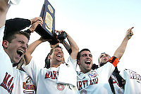 Maryland's seniors, (from left) Michael Dello-Russo, Chris Lancos, Jason Garey, and Kenney Bertz celebrate after being given the championship trophy. The University of Maryland Terrapins defeated the University of New Mexico Lobos 1-0 in the Men's College Cup Championship game at SAS Stadium in Cary, NC, Friday, December 11, 2005.