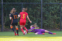 Goalkeeper Lise Musique (1) of Belgium catches the ball before Lotte Keukelaar (11) of the Netherlands can get to it during an international friendly female soccer game between the national teams of Belgium , called the Red Flames U17 and the Netherlands on Wednesday 8th of September 2020  in Kalmthout , Belgium . PHOTO SPORTPIX.BE | SPP | SEVIL OKTEM