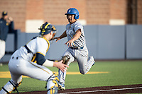 San Jose State Spartans catcher Johnny Mendoza (9) attempts to score against the Michigan Wolverines on March 27, 2019 in Game 2 of the NCAA baseball doubleheader at Ray Fisher Stadium in Ann Arbor, Michigan. Michigan defeated San Jose State 3-0. (Andrew Woolley/Four Seam Images)