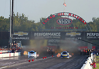 Sep 1, 2019; Clermont, IN, USA; NHRA funny car driver John Force (left) races alongside Ron Capps during qualifying for the US Nationals at Lucas Oil Raceway. Mandatory Credit: Mark J. Rebilas-USA TODAY Sports
