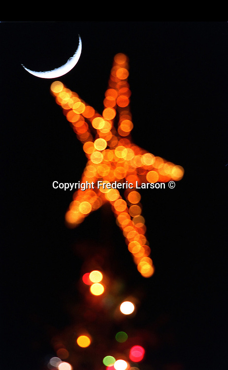 The Macys Christmas tree star at Union Square in San Francisco had its own waxing crescent moon as an ornament. .