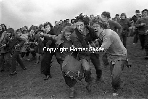 Bottle Kicking and Hare Pie Scrambling. Hallaton Leicestershire. England 1973. Easter Monday annually.<br /> Anthony Norman centre with bottle, he made a long run down the hill, and is about to score a goal for Hallaton.