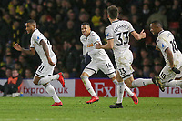 (L-R) Luciano Narsingh of Swansea City celebrates his goal with team mates Martin Olsson, Federico Fernandez and co-scorer Jordan Ayew during the Premier League match between Watford and Swansea City at the Vicarage Road, Watford, England, UK. Saturday 30 December 2017