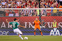 United States goalkeeper Tim Howard (1) faces a shot from Israel Castro (8) of Mexico. The men's national teams of the United States (USA) and Mexico (MEX) played to a 1-1 tie during an international friendly at Lincoln Financial Field in Philadelphia, PA, on August 10, 2011.