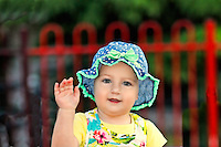 A pretty little girl with blue hat having fun