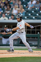 Hernan Iribarren (2) of the Louisville Bats follows through on his swing against the Charlotte Knights at BB&T BallPark on May 12, 2015 in Charlotte, North Carolina.  The Knights defeated the Bats 4-0.  (Brian Westerholt/Four Seam Images)