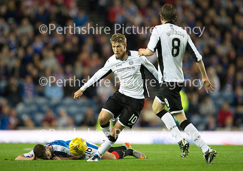 Rangers v St Johnstone...22.09.15  Scottish League Cup Round 3, Ibrox Stadium<br /> David Wotherspoon gets the better of Andy Halliday<br /> Picture by Graeme Hart.<br /> Copyright Perthshire Picture Agency<br /> Tel: 01738 623350  Mobile: 07990 594431