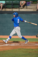 Jose Martinez (2) of the Burlington Royals follows through on his swing against the Bristol Pirates at Boyce Cox Field on July 10, 2015 in Bristol, Virginia.  The Pirates defeated the Royals 9-4. (Brian Westerholt/Four Seam Images)