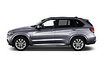 Car driver side profile view of a 2018 BMW X5 Plug-in Hybrid iPerformance 5 Door SUV
