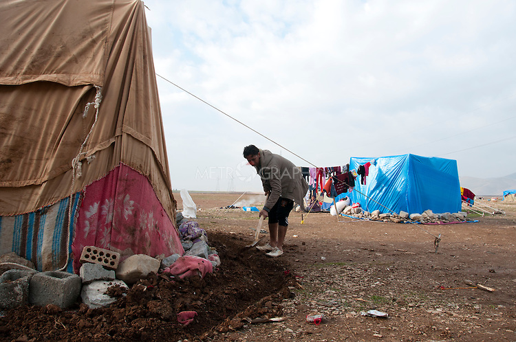 ARBAT, IRAQ: A Syrian man builds a shelter in the Arbat refugee camp...45 families who have fled the violence in Syria are currently living in the Arbat refugee camp 19km outside the Iraqi city of Sulaimaniyah...Photo by Zmnako Ismael/Metrography