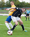 Dundee's Craig Beattie holds off Cowdenbeath's Kenny Adamson.