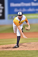 Beer City Tourists pitcher Bryan Baker (33), delivers a pitch during a game against the Lakewood BlueClaws at McCormick Field on June 1, 2017 in Asheville, North Carolina. The Tourists defeated the BlueClaws 8-5. (Tony Farlow/Four Seam Images)