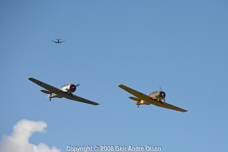To world-war II planes flying in formation during a show at Kjeller airfield outside of Oslo, Norway