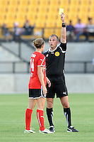 Referee Ted Unkel issues a yellow card to Atlanta defender Katherine Reynolds. The Boston Breakers defeated the Atlanta Beat, 4-1, in Atlanta's home opener, Saturday, April 9, 2011.