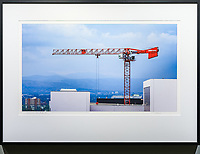 """Construction Boom, Denver<br /> <br /> Signed, Limited Edition Giclee print on fine art paper.<br /> <br /> Image size 12.65""""h x 22.5""""w on 17"""" x 25"""" sheet. Framed size 20.75""""h x 28.75""""w. Nielsen 117 Matte Black frame with non-glare acrylic glazing.<br /> <br /> $700. Available thru Beacon Gallery."""