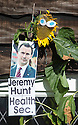 """04/08/16<br /> <br /> The sun may have already set for many of these """"seedy"""" politicians, but that doesn't stop gardener Ralph Beresford from giving his favourite blooms a helping hand to become the tallest sunflower in Derbyshire.<br /> <br /> The 70-year-old planted the flowers in early March and named each one after politicians, adding a mug shot and a pair of eyes to each bright yellow head in the front garden of his bungalow in Belper.<br /> <br /> He said it was his 10-year-old grandson Jamie's idea to pick politicians as this year's theme.<br /> <br /> """"I started doing this as a bit of fun, about ten years ago, and Jamie started to help me as soon as he was old enough.<br /> <br /> """"We've done all sorts of themes, including the Commonwealth Games, Harry Potter, the Queen's 90th birthday and the Olympic games.<br /> <br /> """"But this year we thought we'd do the politicians as they've all been in the news so much.<br /> <br /> """"Boris Johnson is definitely winning the race so far, he's around 12ft now, but Theresa May is hot on his heels in second place, closely followed by Diane Abbott.<br /> <br /> """"But Jeremy Hunt is on his way out, it looks like he'll be the first to go to seed.""""<br /> <br /> All Rights Reserved, F Stop Press Ltd. +44 (0)1773 550665"""