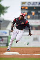 Batavia Muckdogs first baseman Lazaro Alonso (19) rounds third base on a J.C. Millan (not shown) triple in the bottom of the first inning during a game against the Lowell Spinners on July 12, 2017 at Dwyer Stadium in Batavia, New York.  Batavia defeated Lowell 7-2.  (Mike Janes/Four Seam Images)