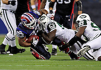 3 December 2009: Buffalo Bills' running back Marshawn Lynch (23) is tackled during a game against the New York Jets at the Rogers Centre in Toronto, Ontario, Canada. The Bills fell to the Jets 19-13. Mandatory Credit: Ed Wolfstein Photo
