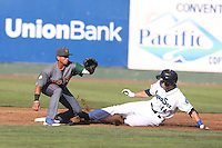 Bryant Flete #28 of the Boise Hawks waits for the throw as Kyle Petty #44 of the Everett AquaSox slides into second base during a game at Everett Memorial Stadium on July 25, 2014 in Everett, Washington. Everett defeated Boise, 3-1. (Larry Goren/Four Seam Images)